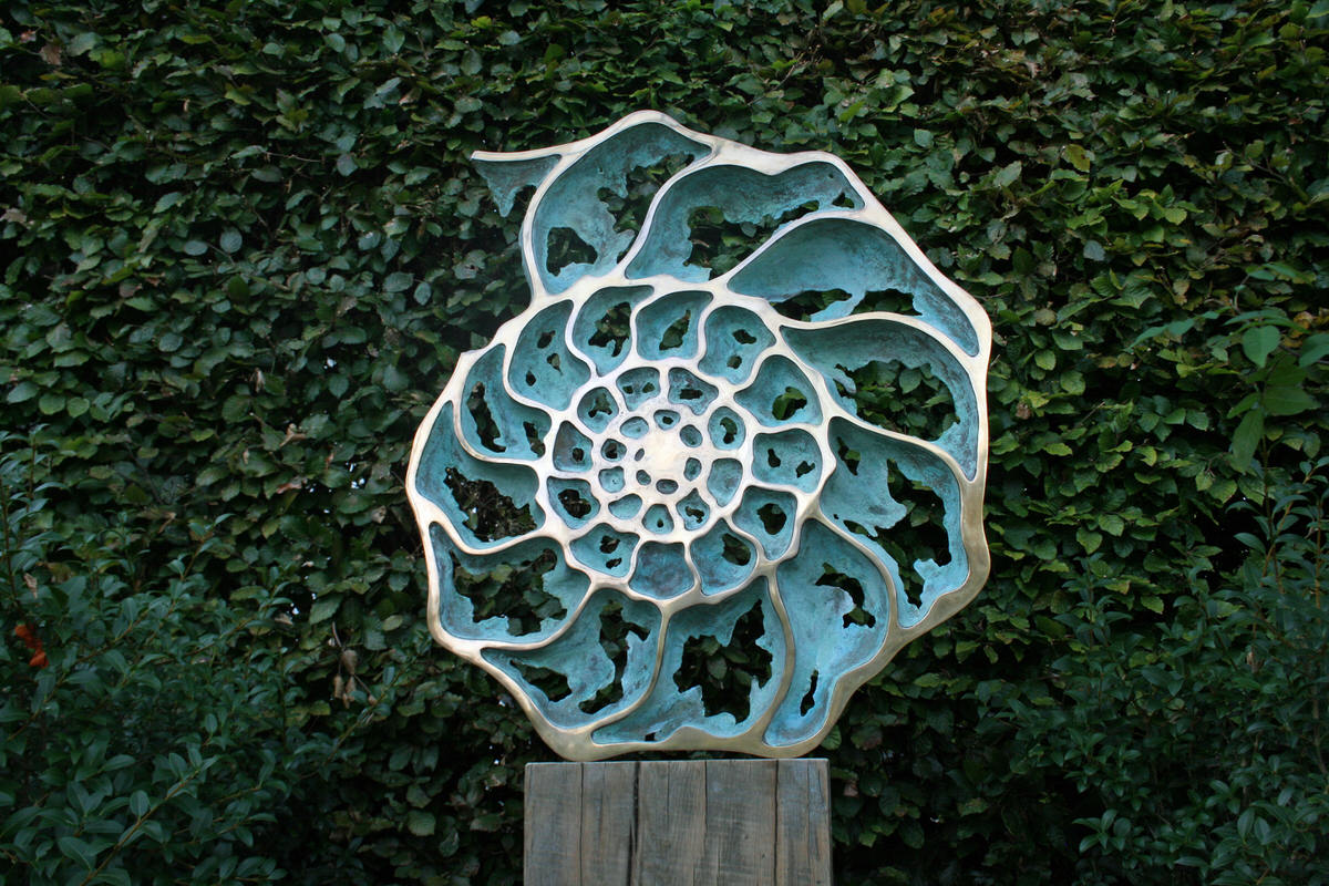 Ammonite slice inside mirror verdigris and gold plated bronze  sculpture corporate sculpture sculpture for specifiers Dubai sculpture  for Christie's  London by Mark Reed