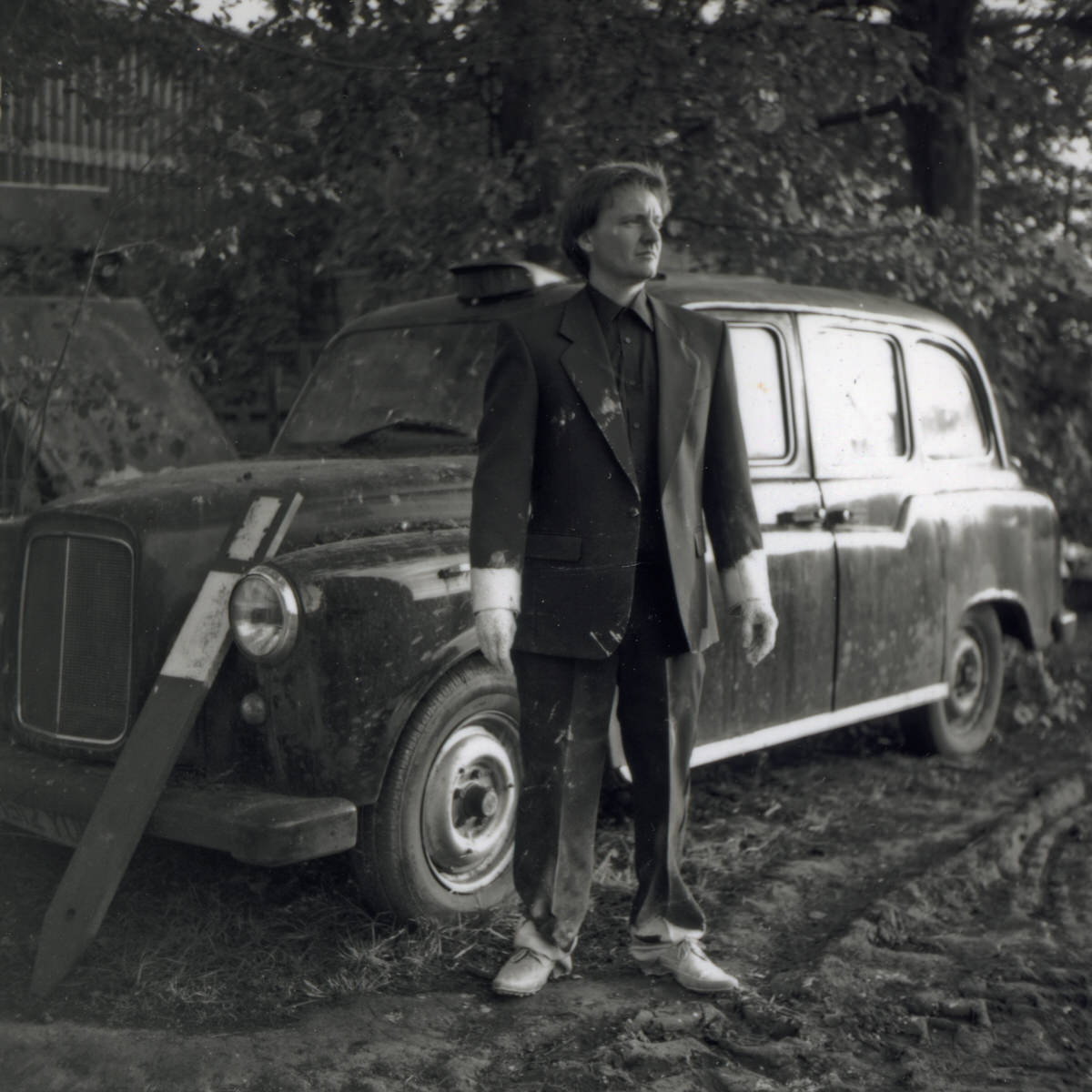 Mark Reed contemporary metal sculptor at studio in England with London Black Cab