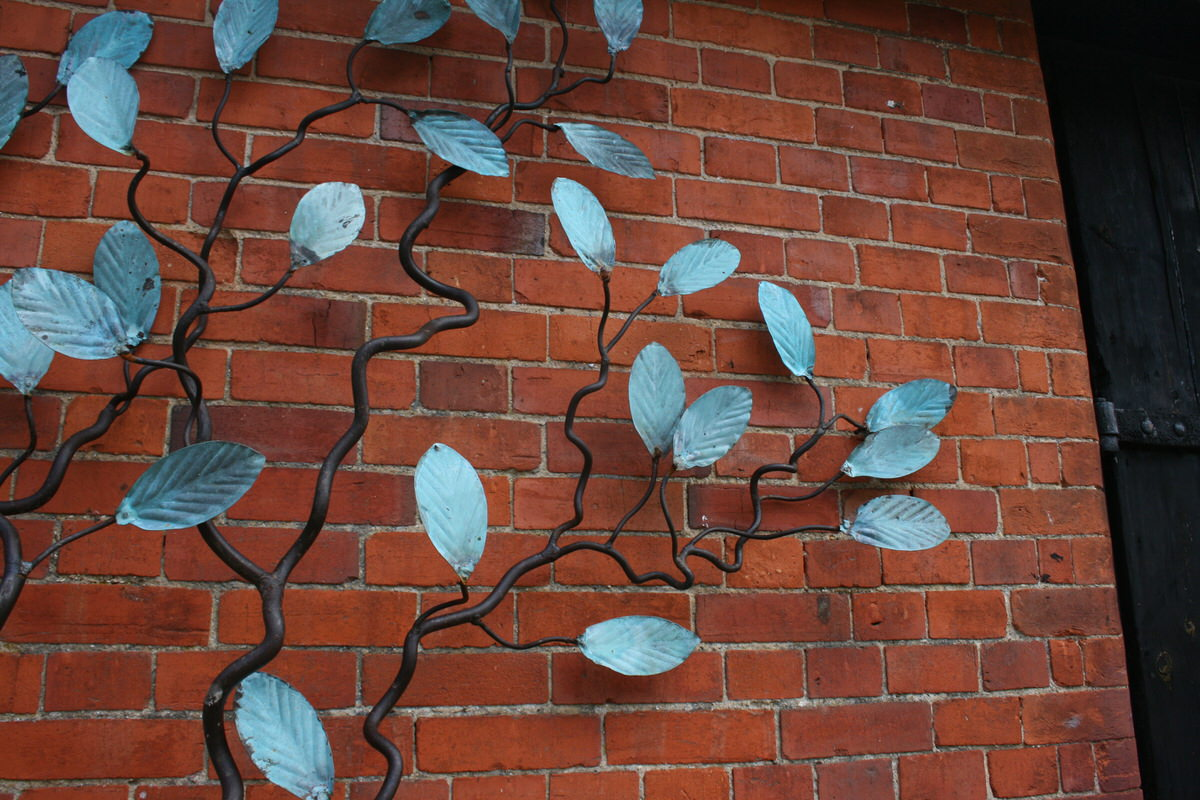 Espalier Tree Wall Sculpture wall climbing with verdigris leaves detail for specifers & architects by Mark Reed