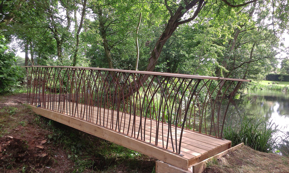 Prince's Trust Bridge bespoke metal bridge for gardens in garden by Mark Reed