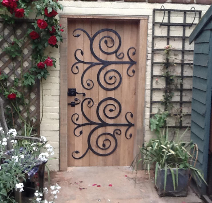 swirly door forged steel and french oak bespoke unique commission garden furniture door by Mark Reed