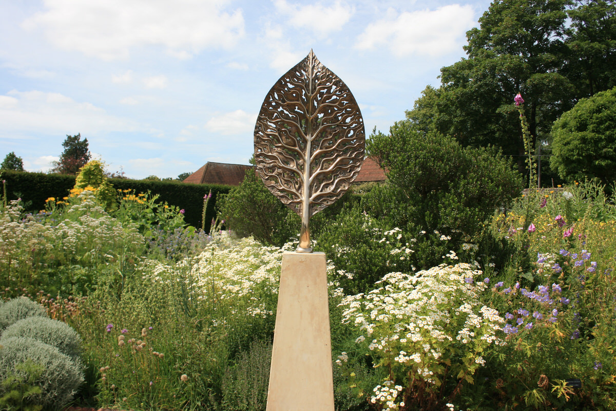 Life Leaf Sculpture Bronze Sculpture in English Cottage Garden Landscape sculpture Garden Sculpture by Mark Reed