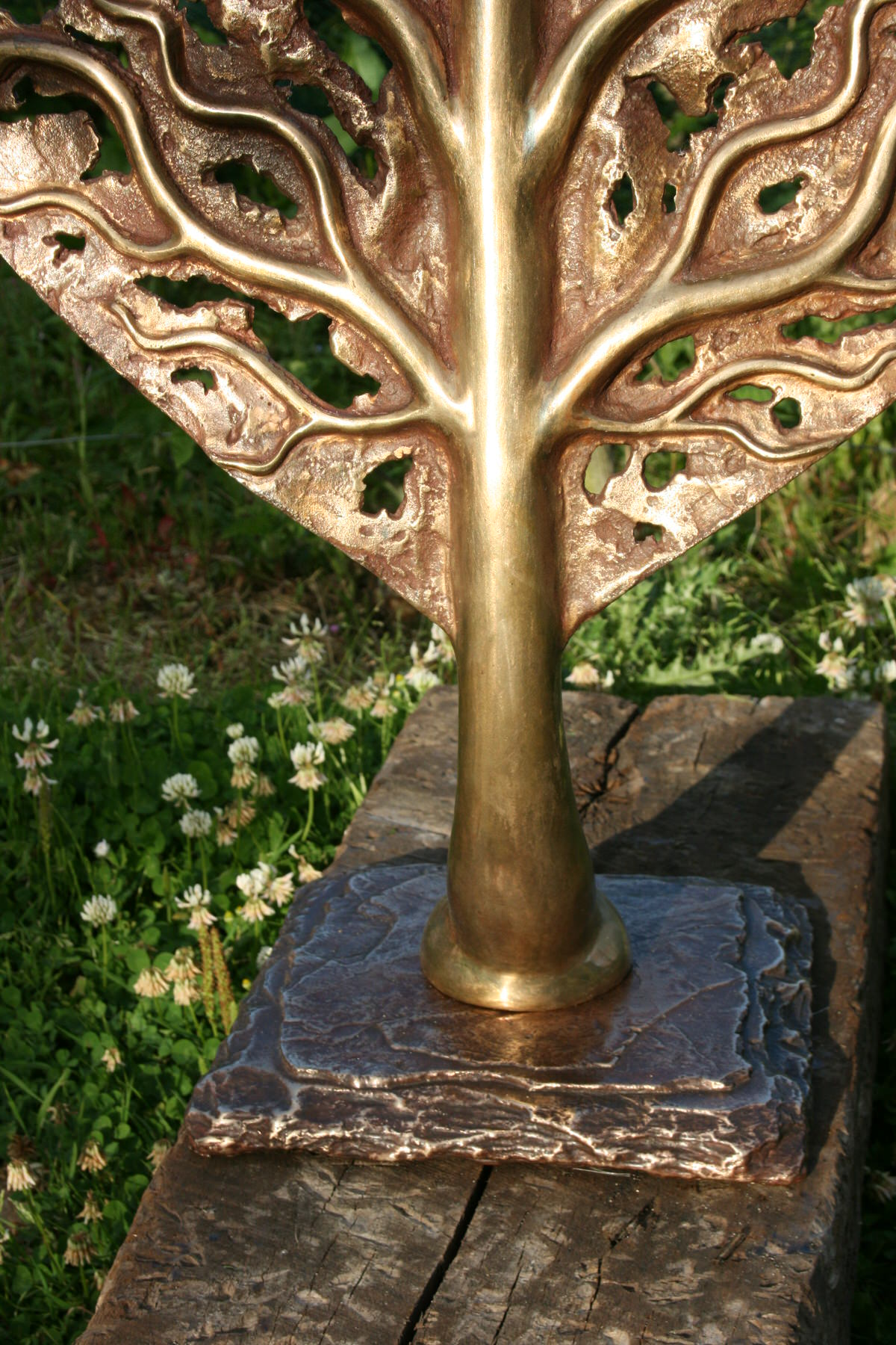 life leaf bronze sculpture with bronze slate base garden sculpture for landscape architects by Mark Reed