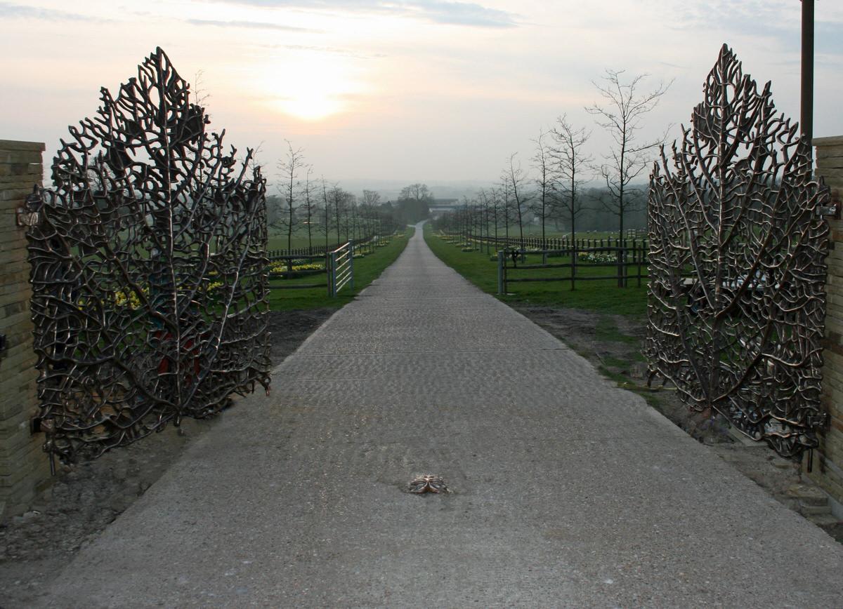 Skeleton leaf gates sculptural bronze driveway estate gates bespoke commission by Mark Reed