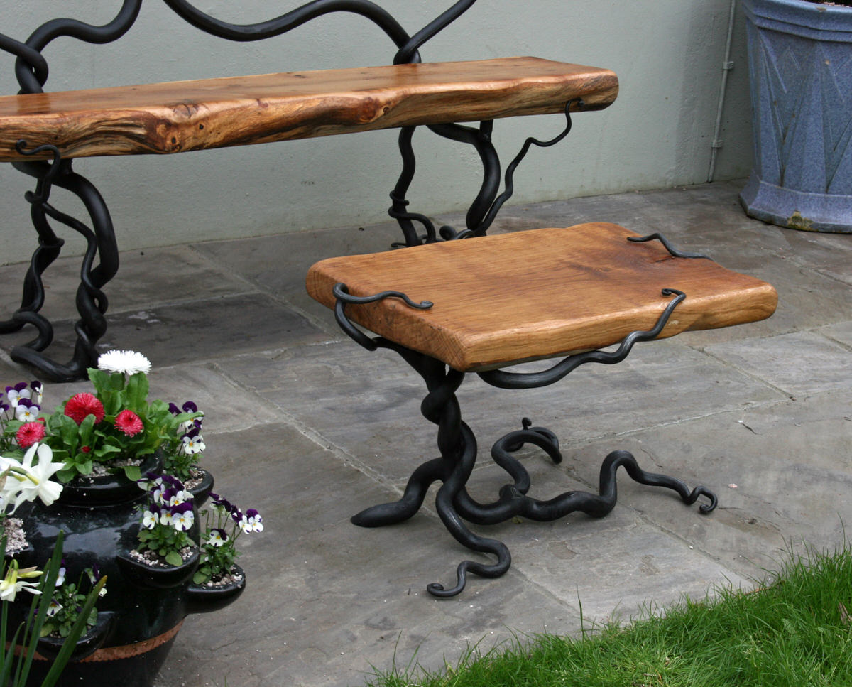rustic bench and table unique bespoke garden furniture in forged steel and oak by Mark Reed