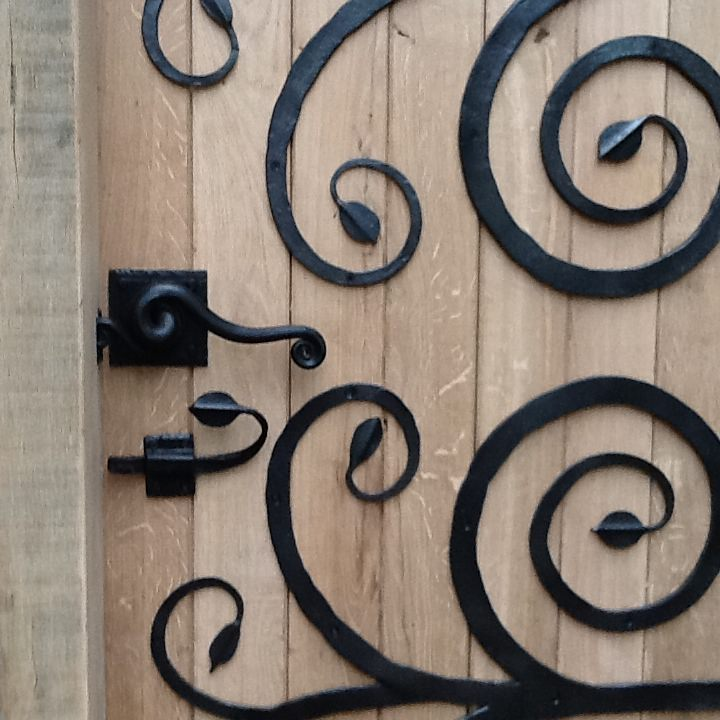 swirly door forged steel  bespoke unique commission garden furniture door by Mark Reed